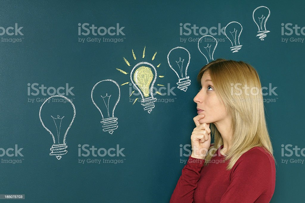 Young Woman Thinking A Big Idea stock photo