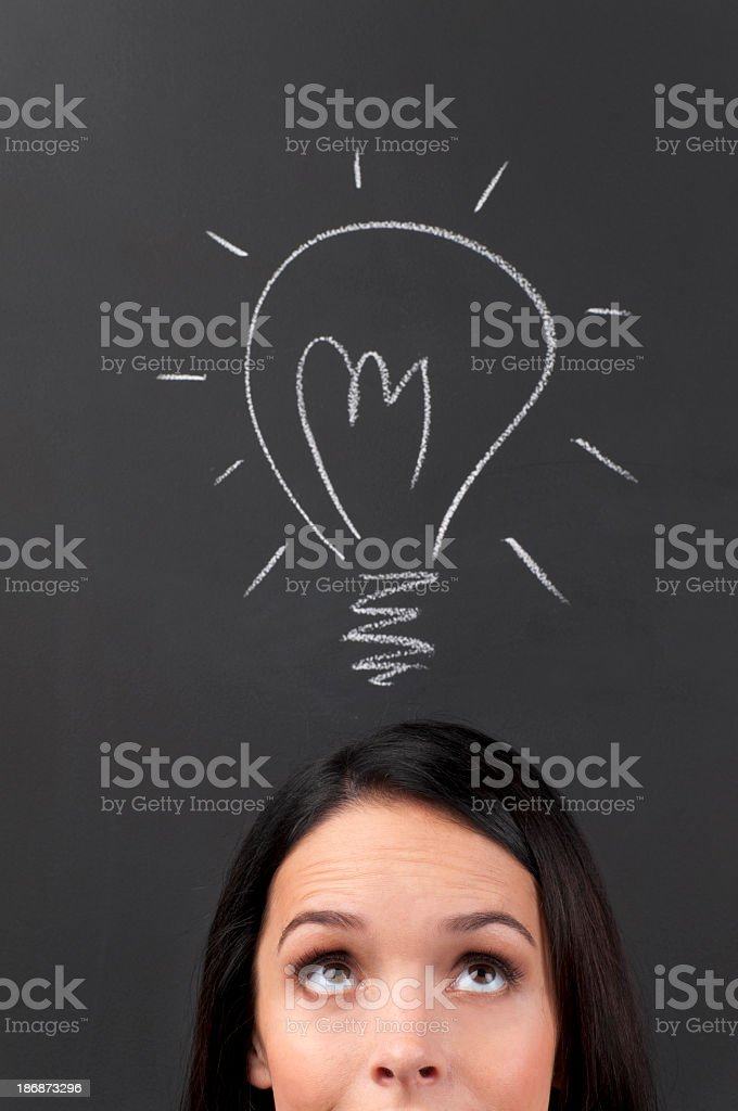 Young Woman Thinking a big idea royalty-free stock photo