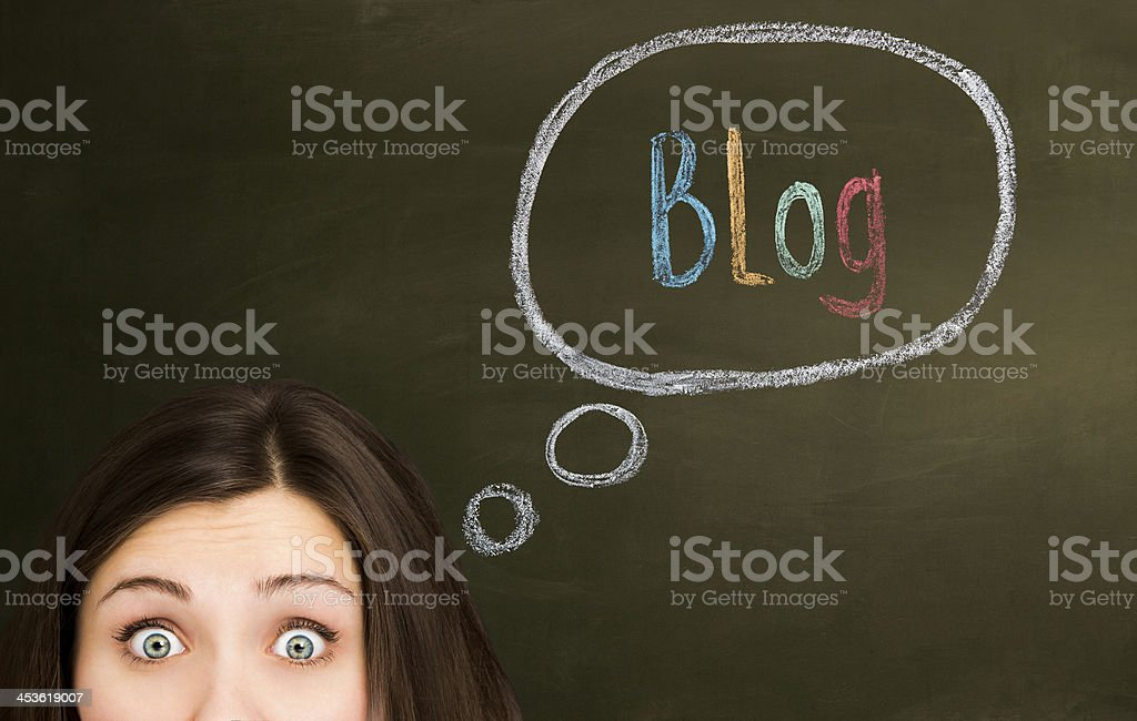 Young woman thinking about Blog. royalty-free stock photo