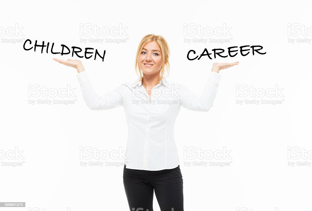 Young woman thinking about Career or Children stock photo