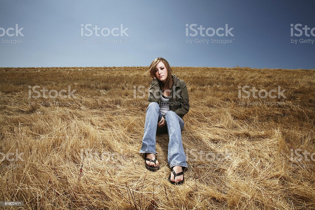 Young Woman Thinking in a Field royalty-free stock photo