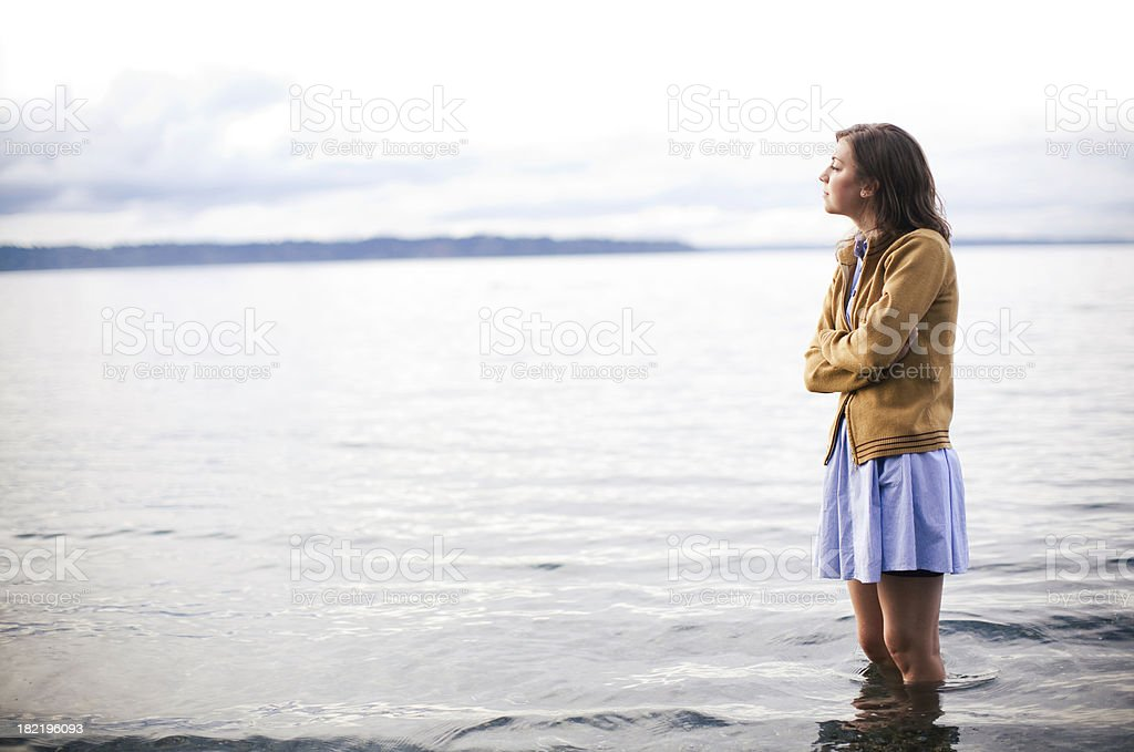 Young Woman Thinking & Wading in Water royalty-free stock photo