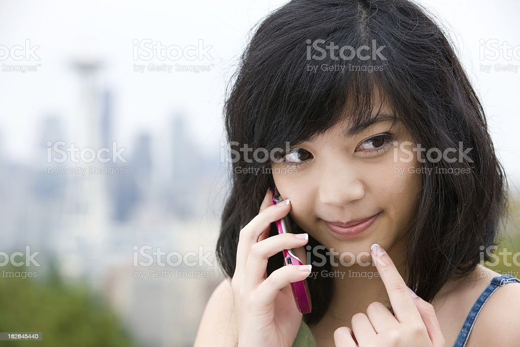 Young Woman Thinking While Talking On Cell Phone royalty-free stock photo