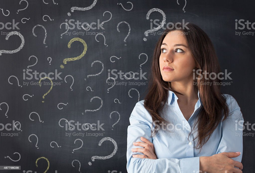 Young woman thinking with blackboard stock photo