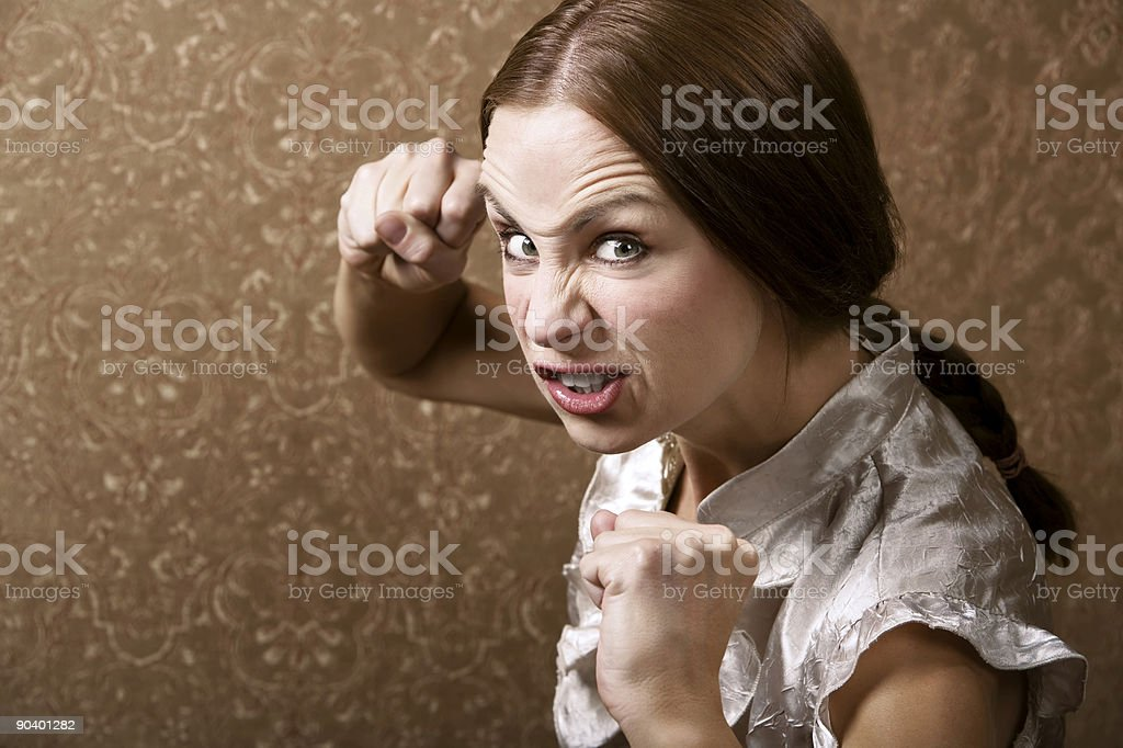 Young Woman Throwing a Punch stock photo