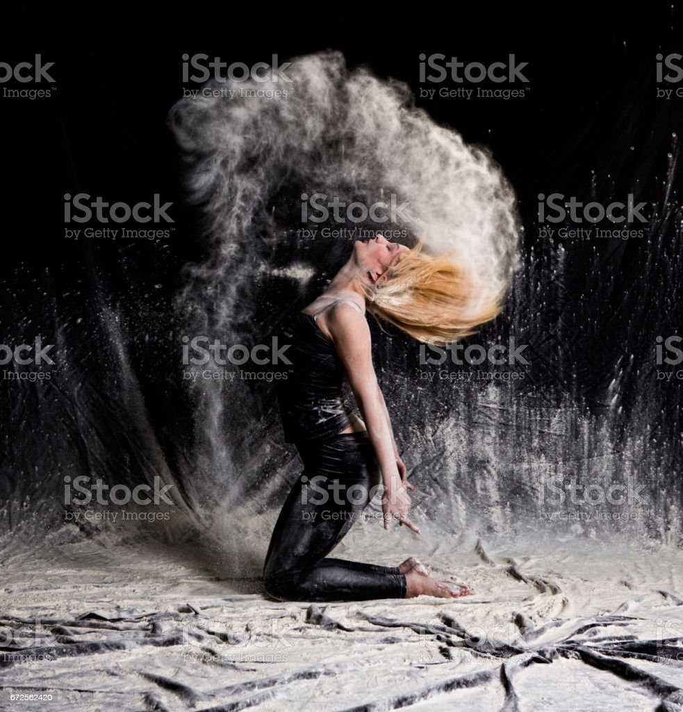 Young woman throwing dust and powder in studio at istanbul turkey stock photo