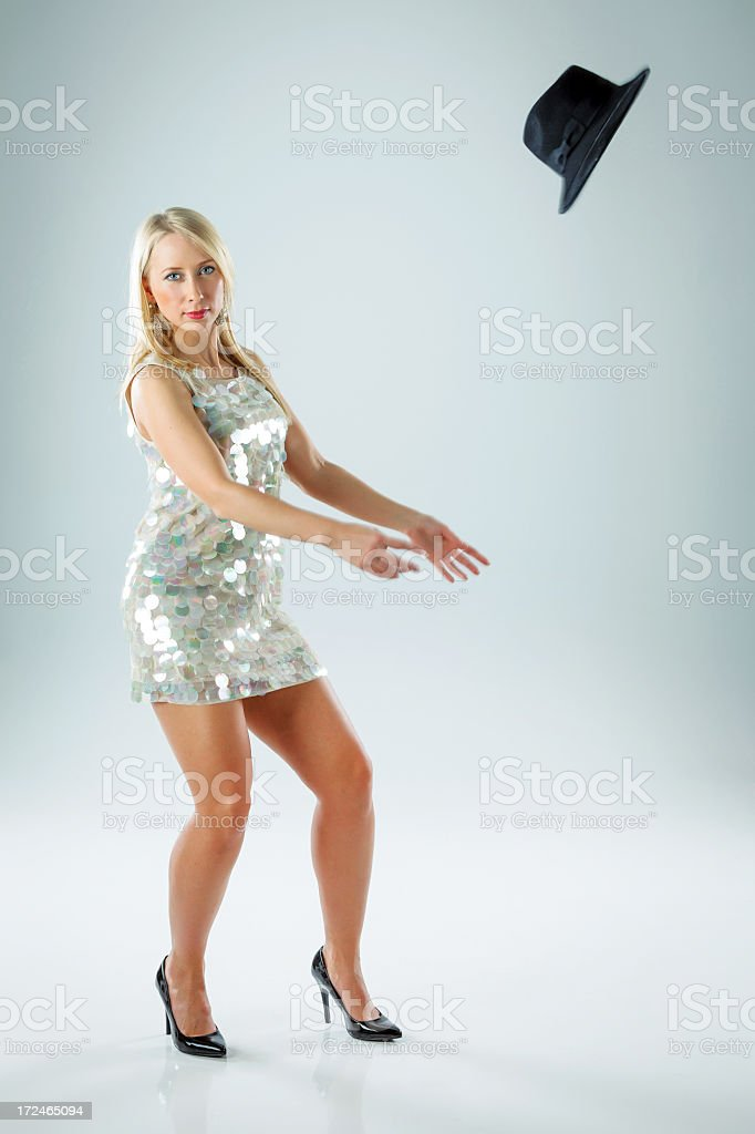 Young woman throwing hat in the air royalty-free stock photo