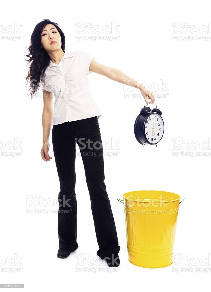 Young Woman Throws Away an Alarm Clock royalty-free stock photo