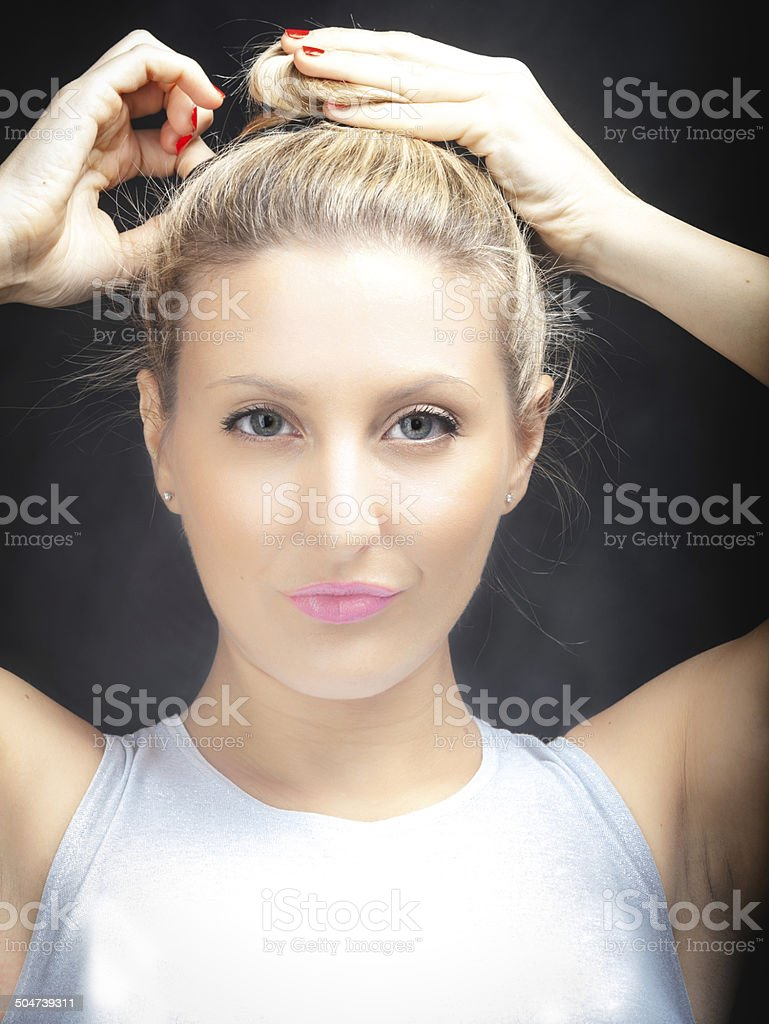 Young woman touching her hair. Color image stock photo