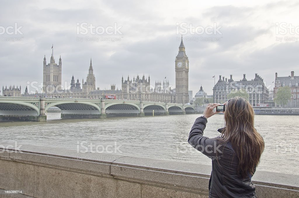 Young Woman Tourist Taking Pictures Of London Landmarks stock photo