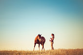Young Woman Training Horse