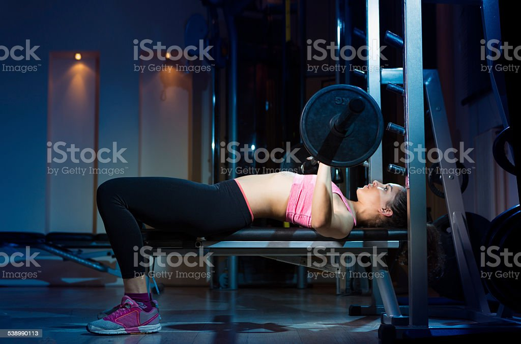 Young woman training in the gym stock photo