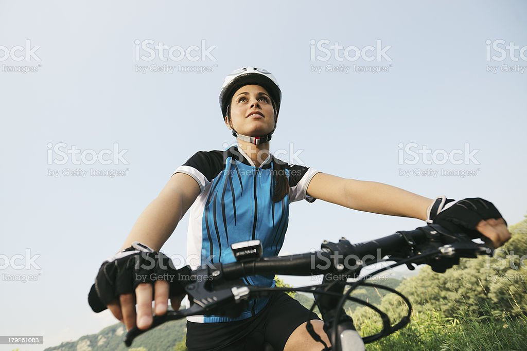 young woman training on mountain bike and cycling in park royalty-free stock photo
