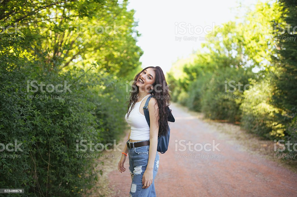 Young woman traveler in nature stock photo