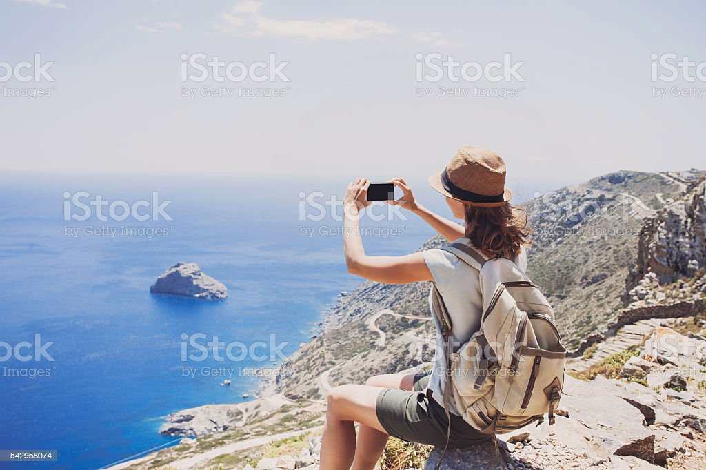 Young woman traveler on vacations stock photo