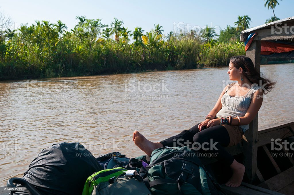 Young woman traveling around the world stock photo