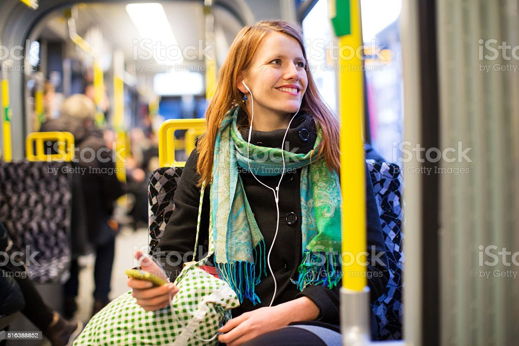 Young woman traveling by underground railway stock photo