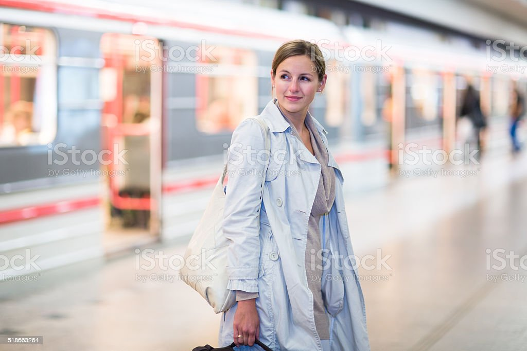 Young woman traveling in the subway stock photo