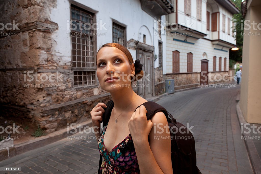 Young woman traveller in Kaleici (old town of Antalya) royalty-free stock photo