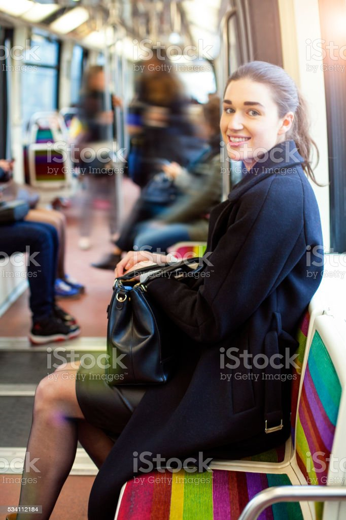 Young woman travelling in a train of Parisian underground stock photo