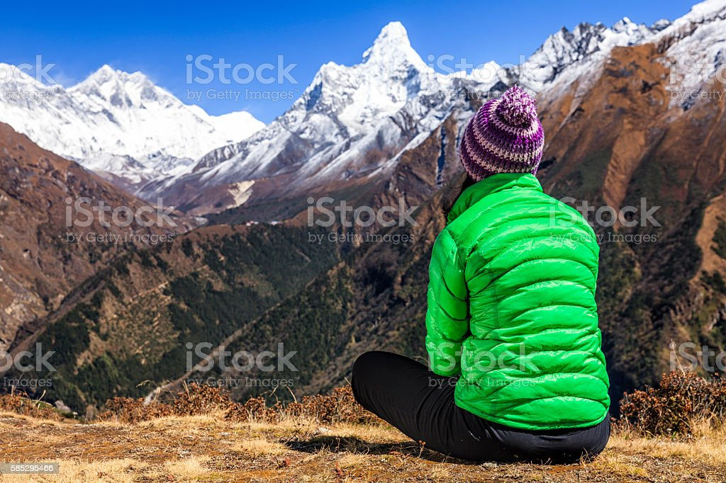 Young woman trekking in Himalayas, Mount Everest National Park stock photo