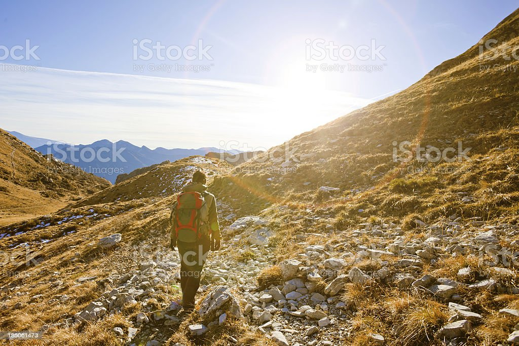 Young Woman Trekking in the Dolomites royalty-free stock photo