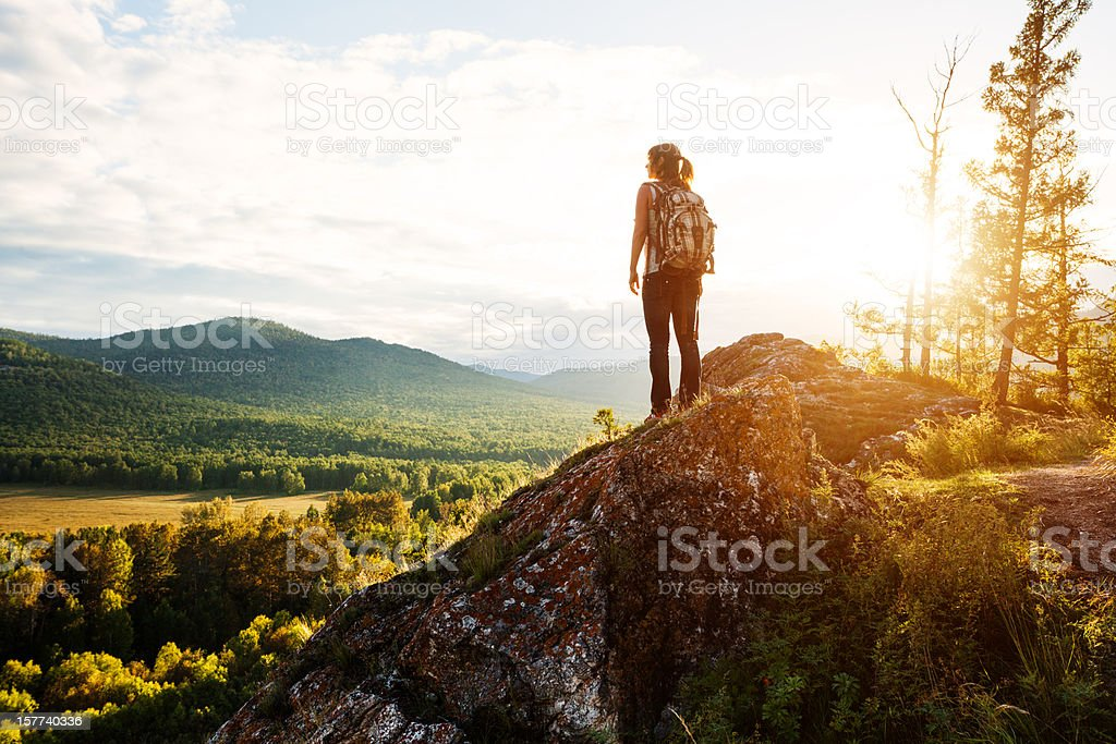 young woman trekking stock photo