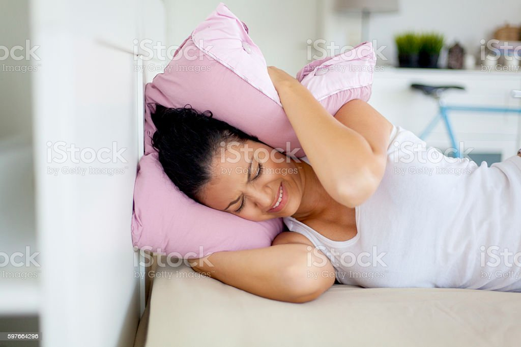 young woman trying not to wake up stock photo