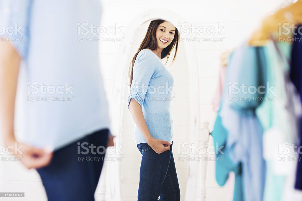 Young Woman Trying On Clothes stock photo