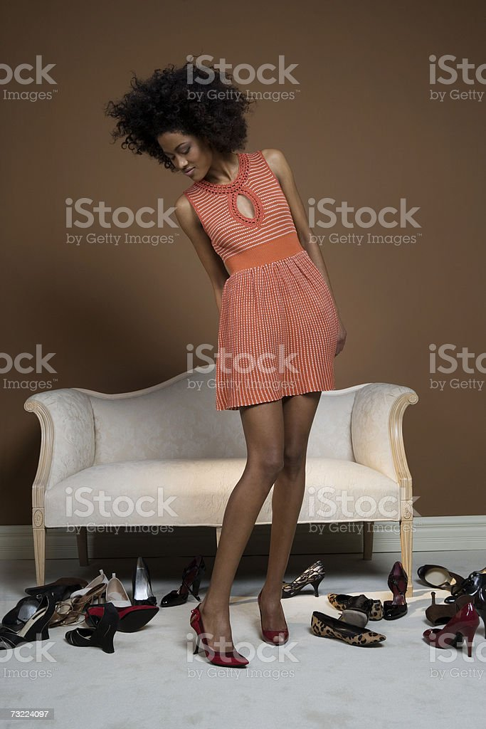 Young woman trying on shoes stock photo