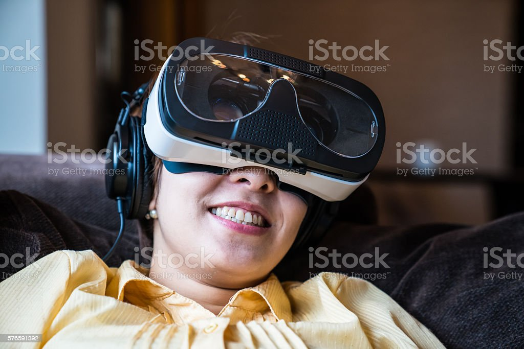 Young woman trying out a virtual reality headset stock photo