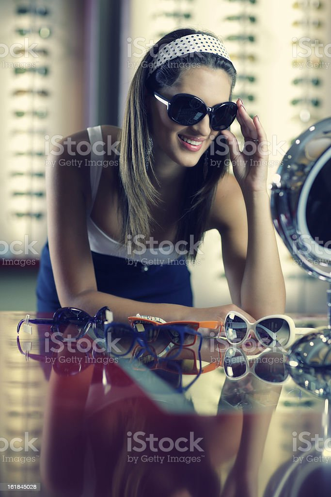 Young Woman Trying Out Sunglasses royalty-free stock photo