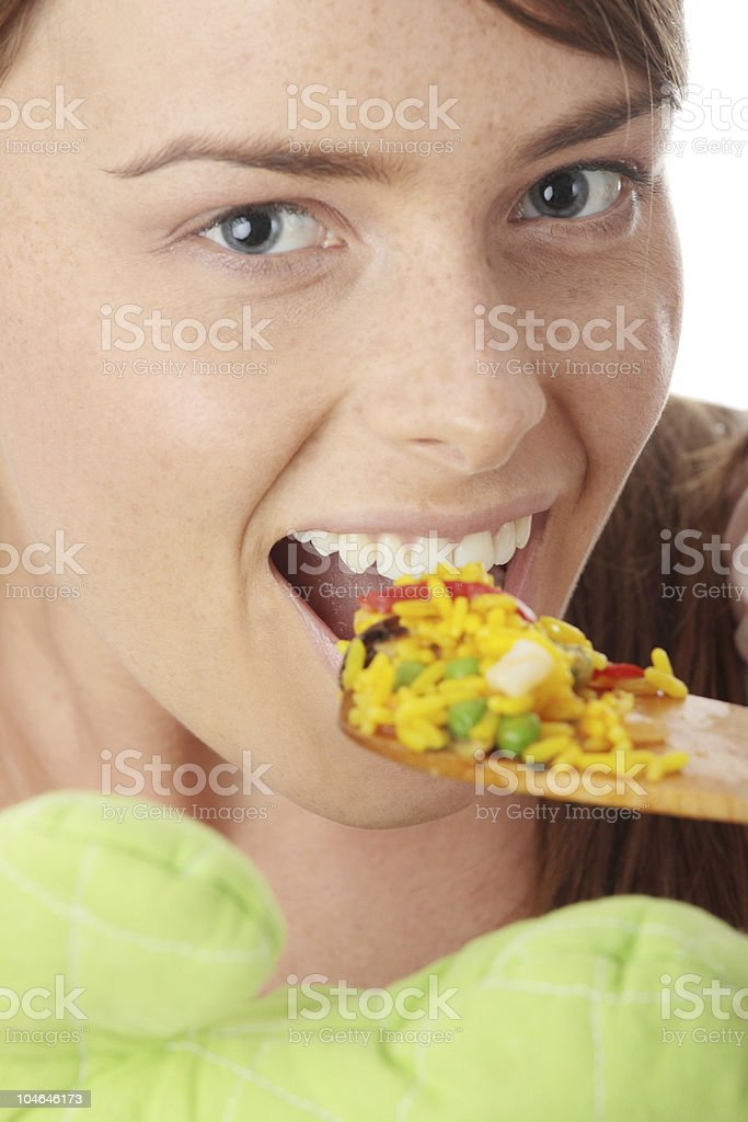 Young woman trying paela royalty-free stock photo