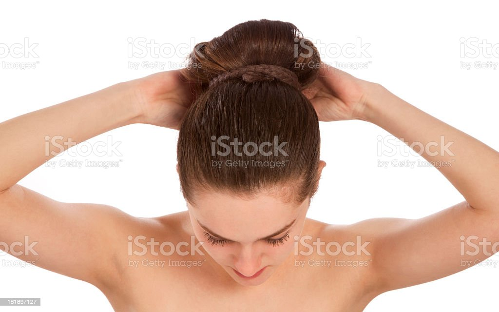 Young woman tying her hair royalty-free stock photo