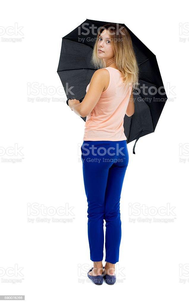 young woman under an umbrella stock photo