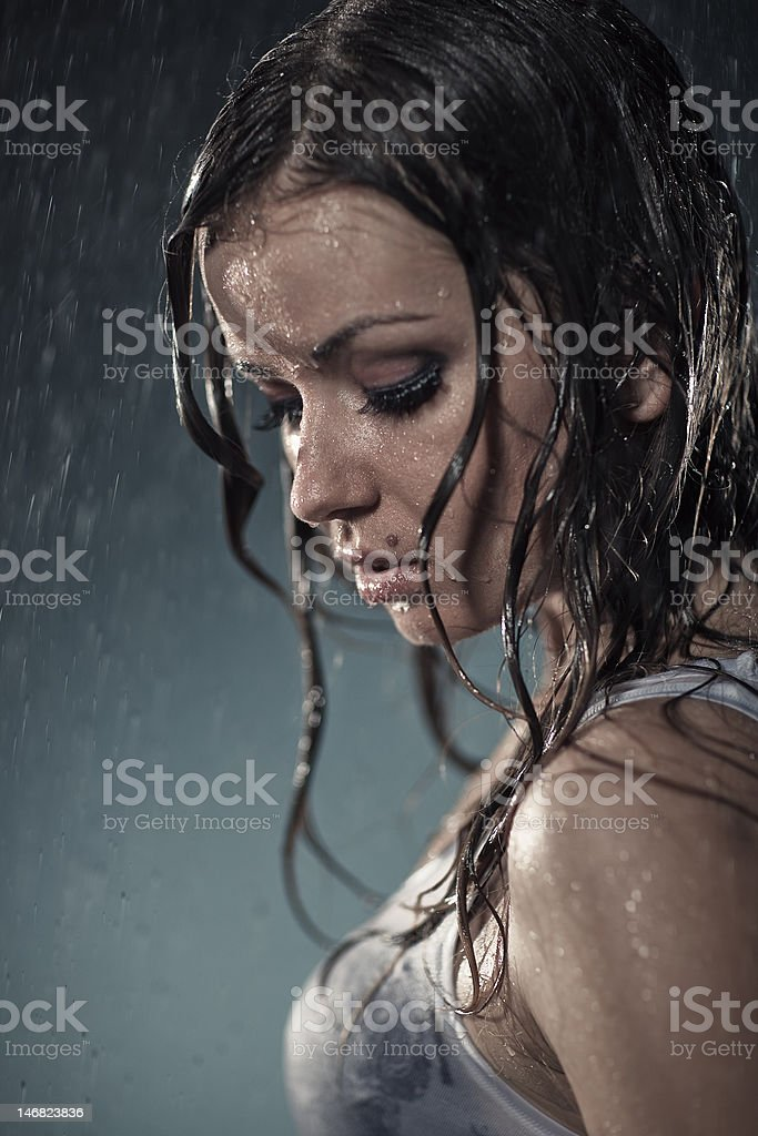 Young woman under the rain royalty-free stock photo