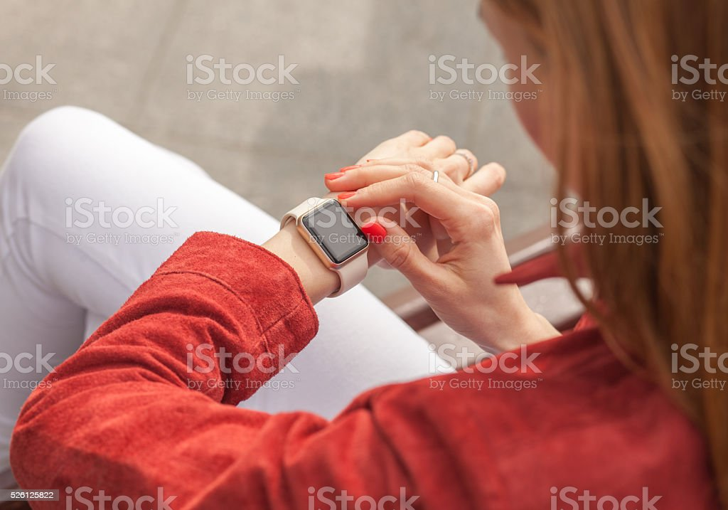 young woman use smart watch with blank screen outdoor stock photo