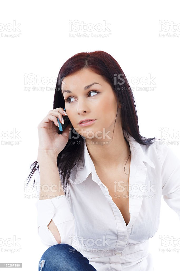Young woman using a cellphone stock photo