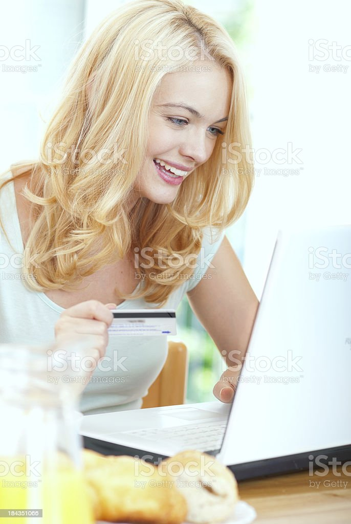 young woman using a credit card for shopping online royalty-free stock photo