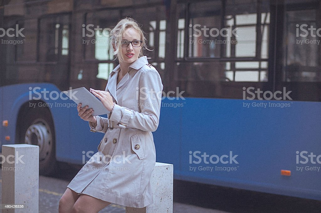 Young woman using a digital tablet in the urban environment stock photo