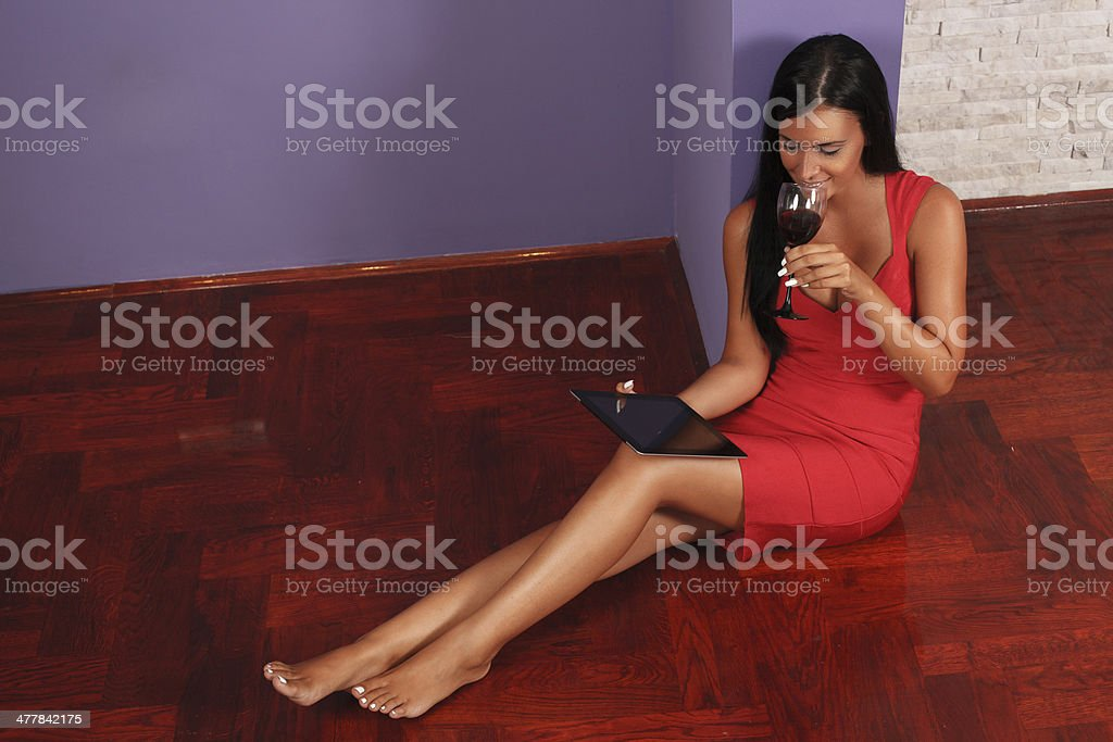 Young woman using a digital tablet royalty-free stock photo