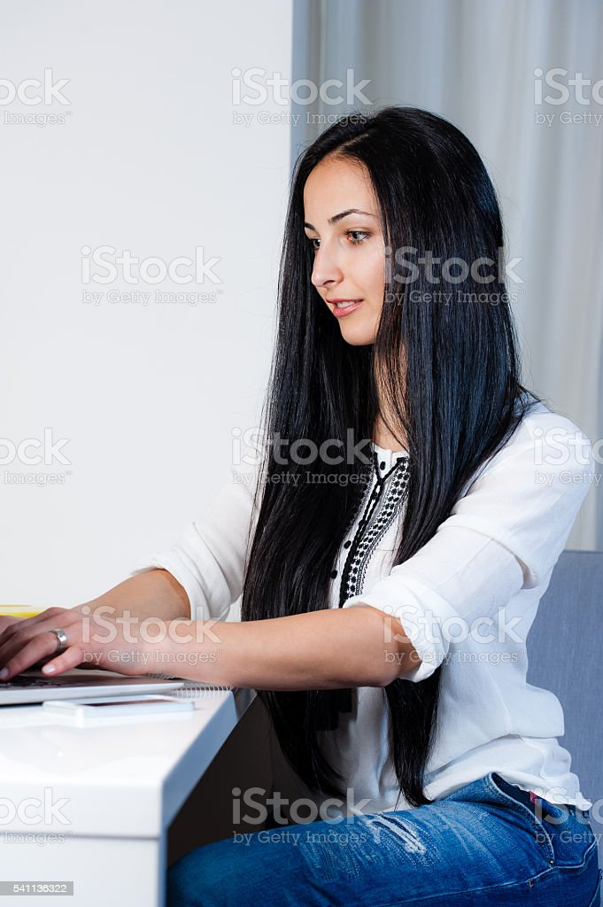 Young woman using a laptop. stock photo