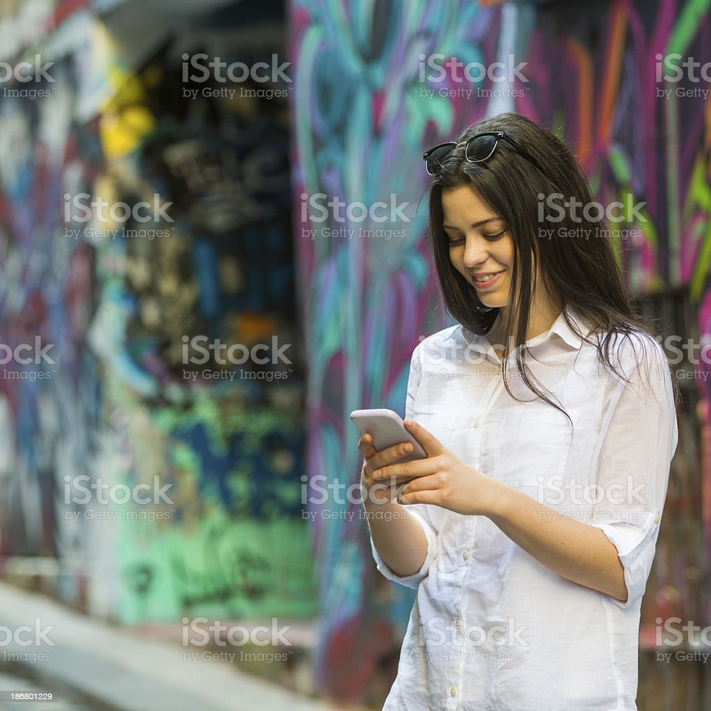 Young Woman Using a Phone royalty-free stock photo