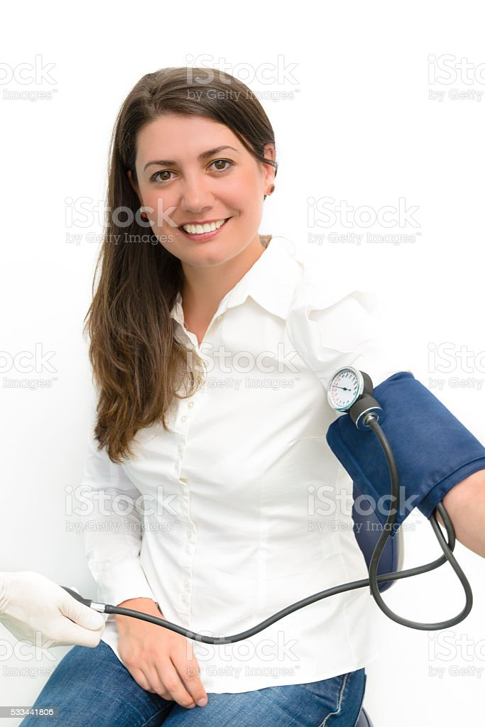 Young woman using a sphygmomanometer stock photo