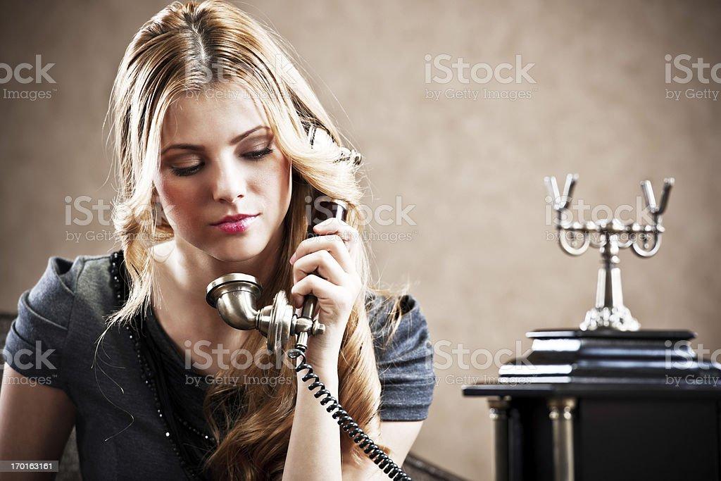Young woman using an antique phone. royalty-free stock photo