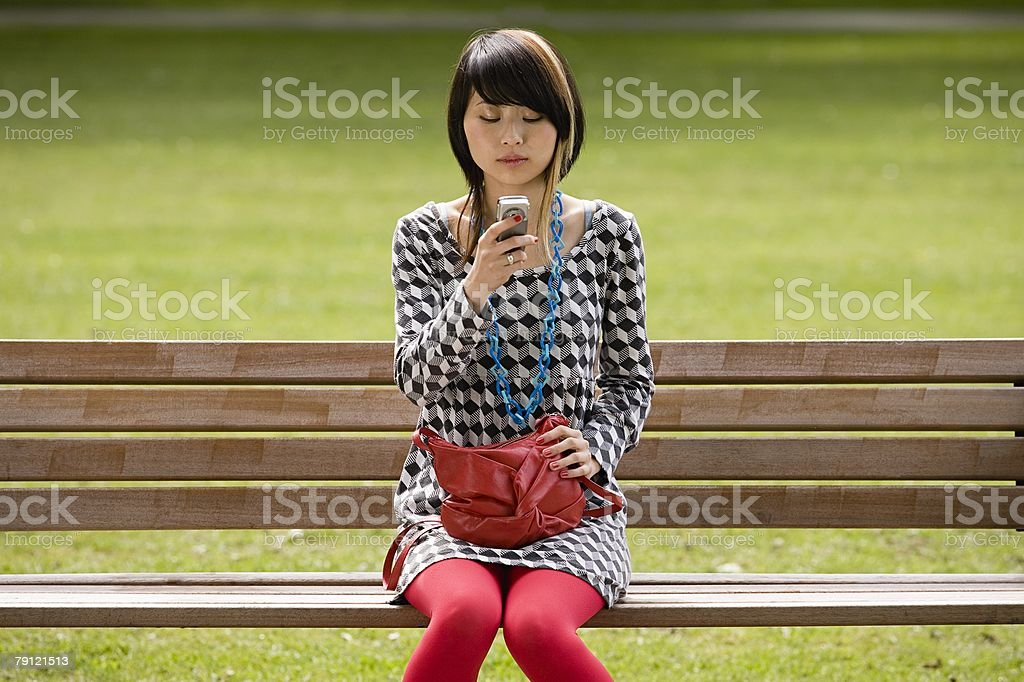 Young woman using cell phone royalty-free stock photo