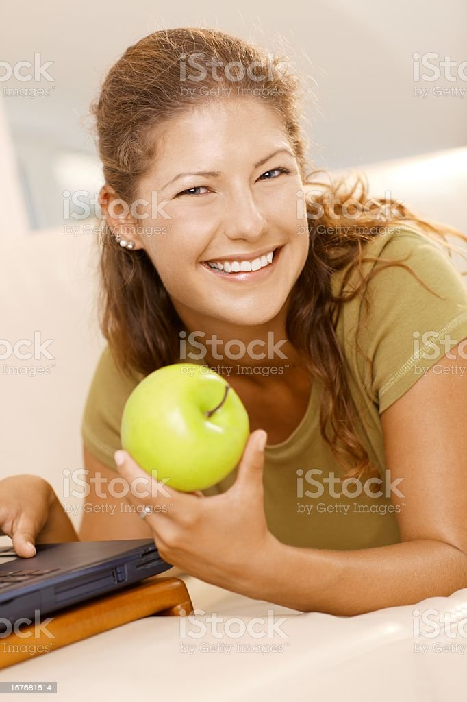 Young woman using computer at home royalty-free stock photo