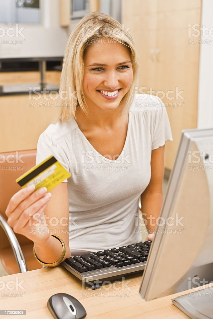 Young woman using computer royalty-free stock photo
