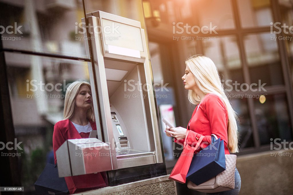 Young woman using credit card stock photo
