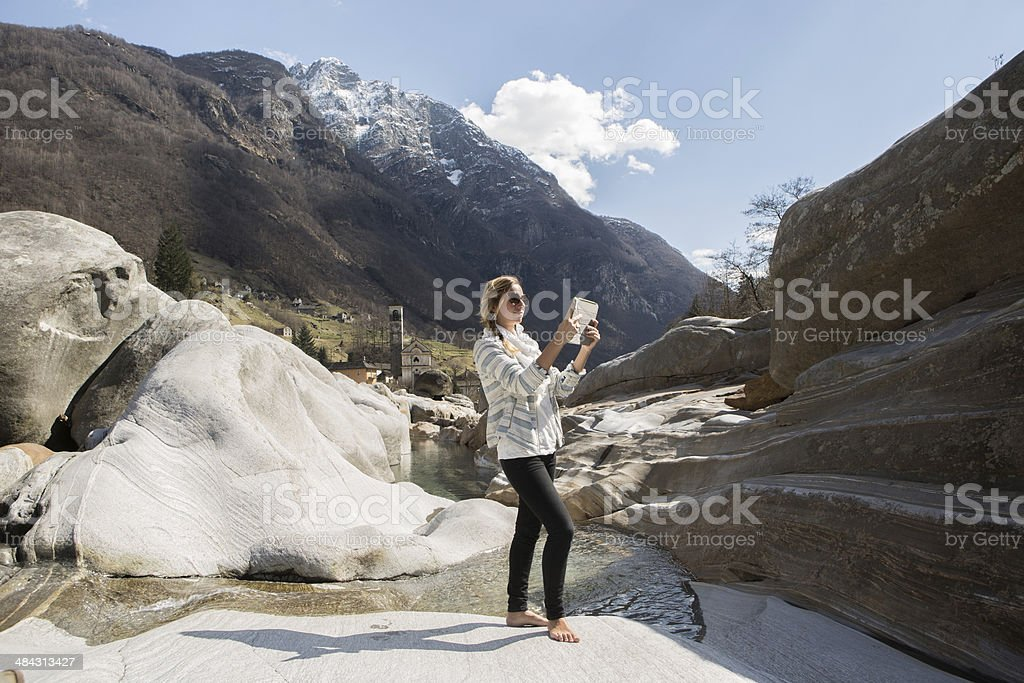 Young woman using digital tablet in nature. royalty-free stock photo